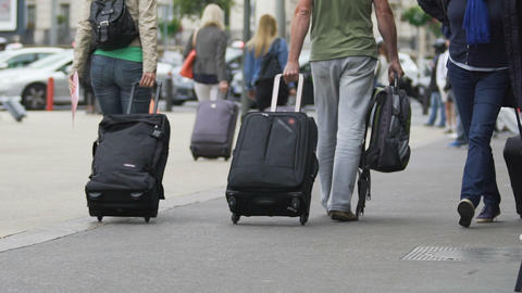 Tourist with suitcase leaving airport, people traveling, slow-motion video Live Action