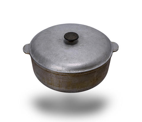 old used aluminum pan with a lid isolated on a white background Photo