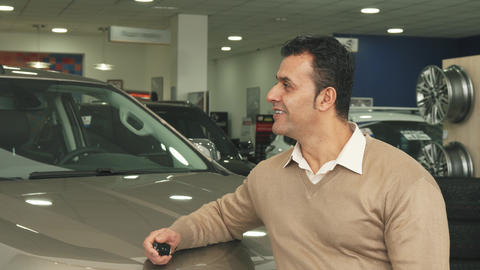A good man examines the car salon and shows a thumbs up Footage