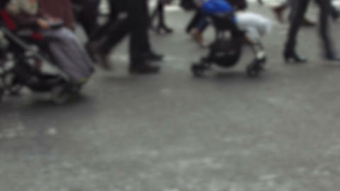Detail of feet passing through a pedestrian crossing Footage