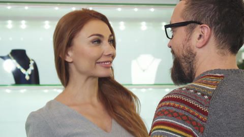 Happy woman smiling embracing her man after shopping at the jewelry store Footage