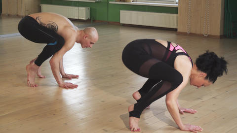 Mature couple doing yoga together indoors Footage