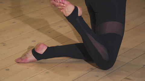 Close up of a beautiful woman practiving yoga in the evening Footage