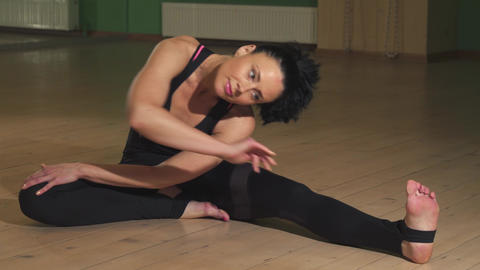 Gorgeous flexible woman stretching her body doing yoga Footage