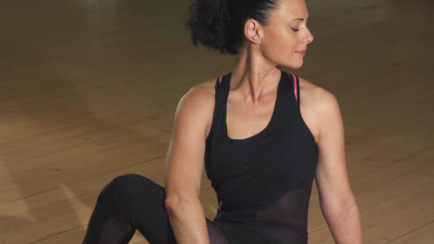 Happy gorgeous relaxed woman exercising sitting in yoga asana position smiling Footage