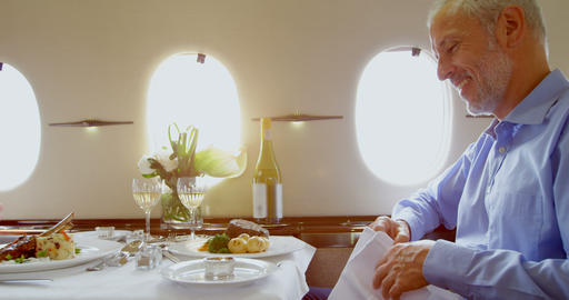 Businessmen having meal in private jet 4k Footage