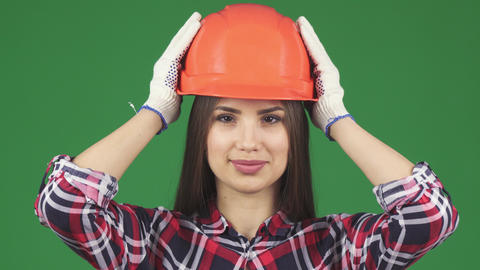 Beautiful female constructionist smiling wearing hardhat Archivo