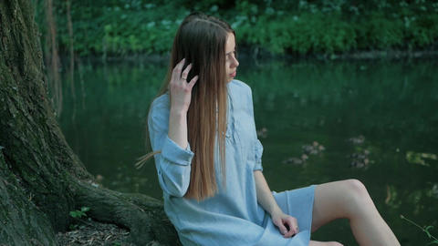 human and nature. beautiful young woman enjoying unity with nature sitting by a Footage