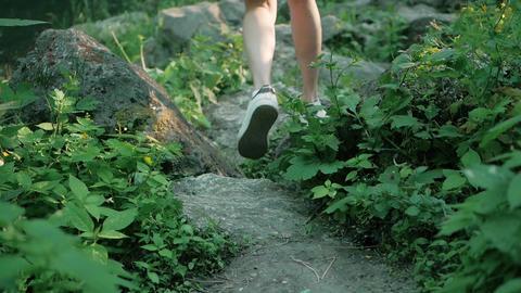 Woman hiker climbs steep rocky terrain Live Action