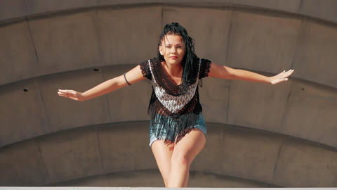 Dancing Female. happy mixed race woman dancing performance with long dreadlocks Live Action