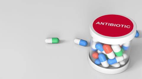 Antibiotic drug capsules in a jar. 3D rendering Photo