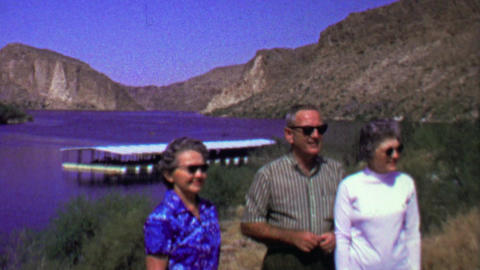 1961: Family lakeside docs enjoying summer sunshine wilderness Footage