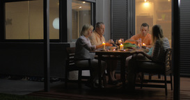 Close-up of family clinking glasses and eating dinner Live Action