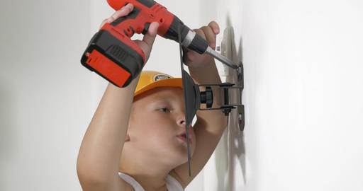 Boy working with electric screwdriver Footage