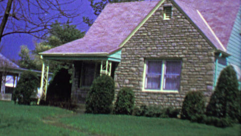 1964: Quaint brick facade bungalow suburban house garage driveway Footage