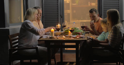 Family having supper on outdoor house terrace Footage