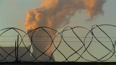 Smoking Chimney behind Barbed Wire Footage