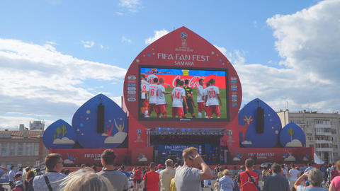 Football fans watch live broadcast of the match in the fan zone of the 2018 FIFA Footage