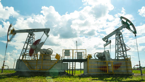 powerful pump jacks extract crude oil on field Footage