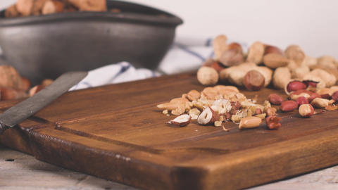 Dry fruits on wooden table GIF