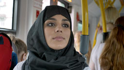 Young muslim woman in sitting in bus, transport concept,... Stock Video Footage