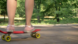 Female legs riding on skateboard in park, asian female hipster on skate and Footage