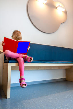 Little girl patient waiting at Doctors Waiting Room Photo