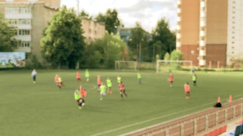 Defocused female junior football players on the field GIF