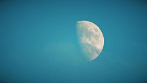 Time lapse of half moon and clouds or smoke, telephoto lens shot Footage