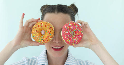 Woman is taking donuts and makes sunglasses from it Footage