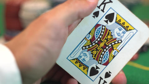 Revealing a blackjack hand of 21 with ace and king spades GIF