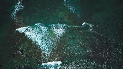 Aerial survey from a drone over the surface of the ocean Footage