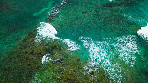 Aerial survey from a drone over the surface of the ocean and the city on the Footage