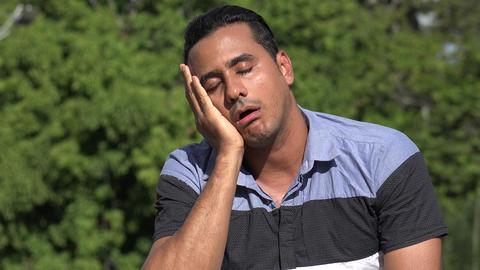 C0243 tired adult hispanic man Live Action