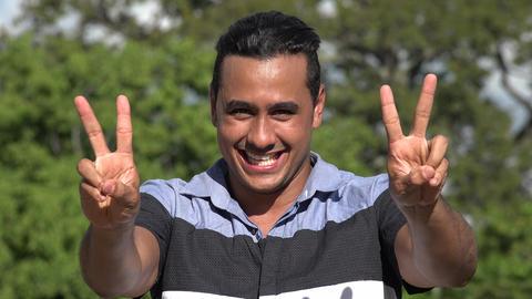 C0281 adult hispanic man and peace gesture Footage