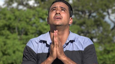 C0283 praying adult hispanic man Live Action