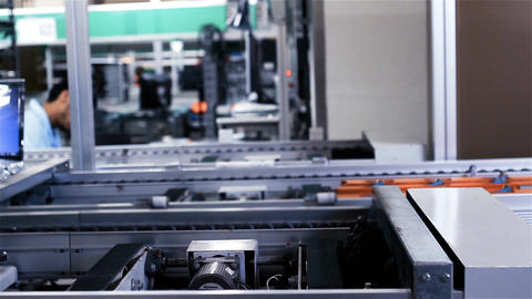 Conveyor Belt On the Assembly Line of a Computer Factory. Laptop Production Live Action