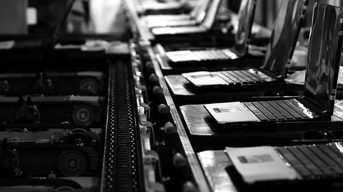 Assembly Line On the Laptop Factory. Black and White Tone. Zoom Out Live Action