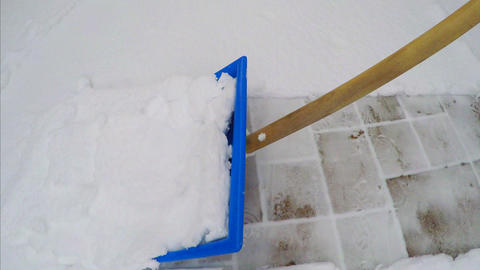 removing snow from the sidewalk Live Action