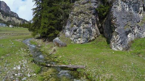 View of mountain rivulet flowing between huge stones, Dolomites, landscape Footage