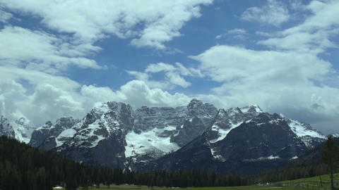 Rebellious clouds floating above calm majestic Dolomites mountain range, Italy Footage