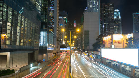Urban traffic in city night with streak lights, time lapse ビデオ