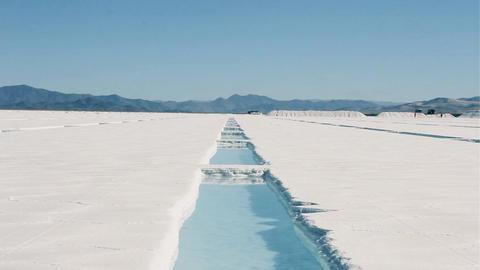 Salt Pool On A Salt Flat Of Argentina. Salt Production. Zoom In Live Action