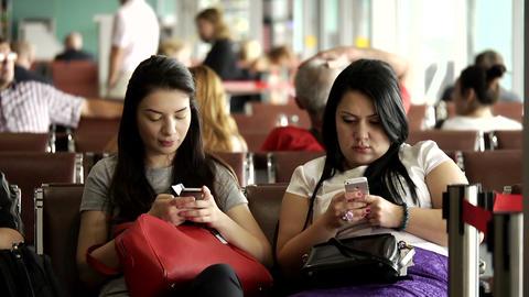 KRASNODAR, RUSSIA - DEC 10, 2015: Girls using iPhone in Krasnodar International Footage