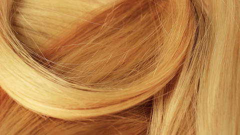 Hair extension cutted hair fibers blonde weft rotating pattern macro texture Footage