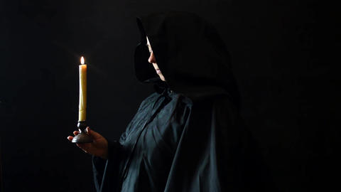 Beautiful nun girl with candle Footage