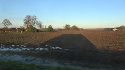 car shadow in motion on autumn fields Live Action