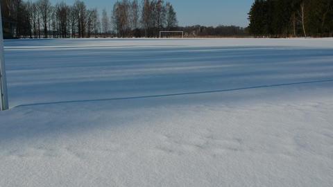 In small winter stadium drone flying through football gate 영상물