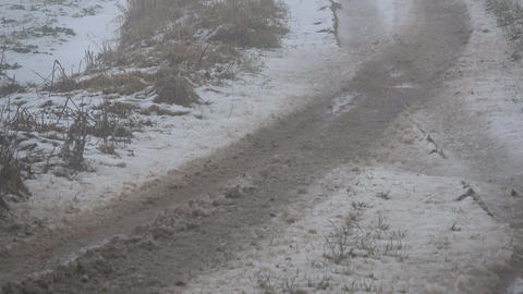 Bad rural road in wet winter snow and dark morning mist Footage