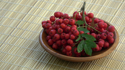 Rotating rowan berries in wooden plate Live Action